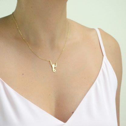 gold monkey necklace worn