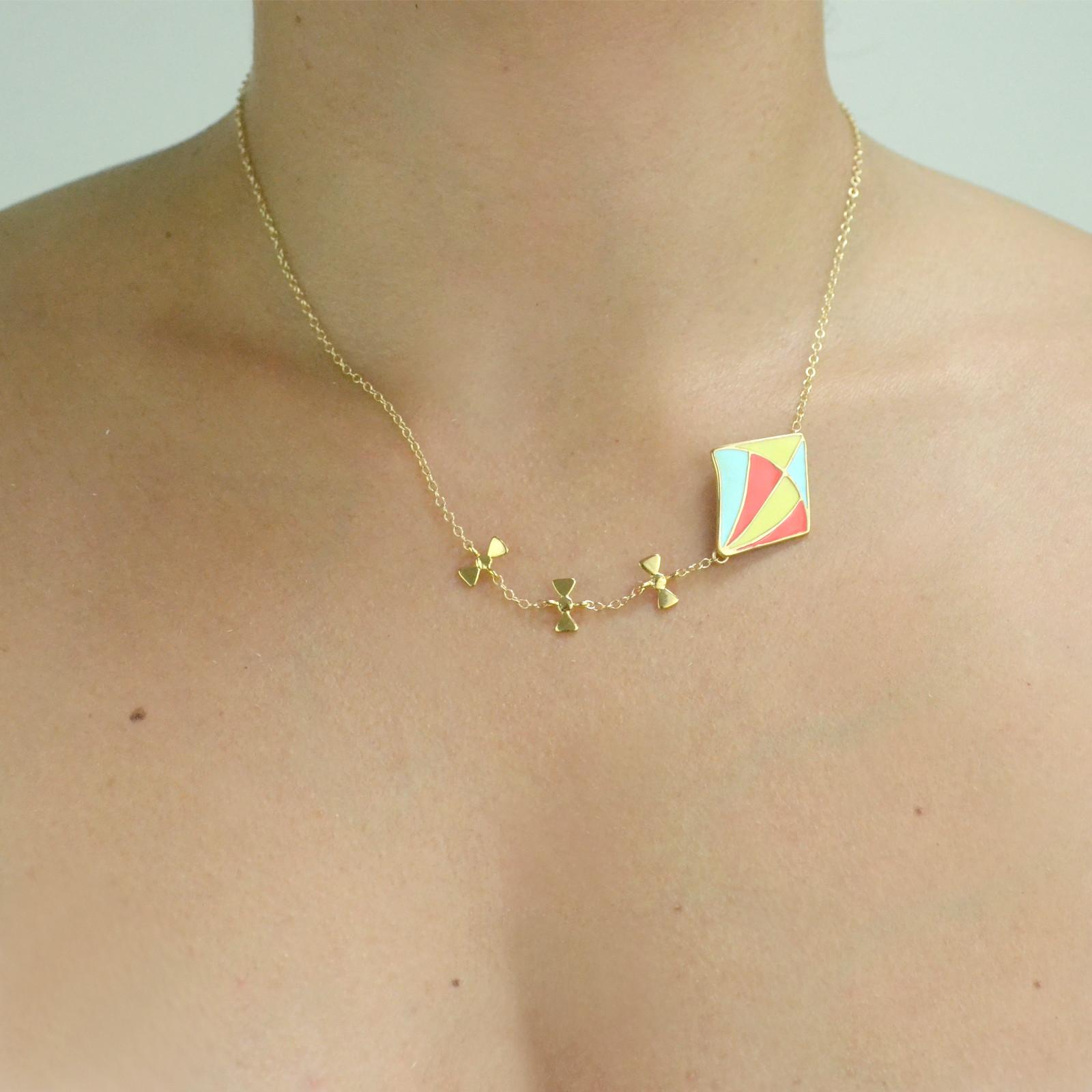kite necklace gold worn