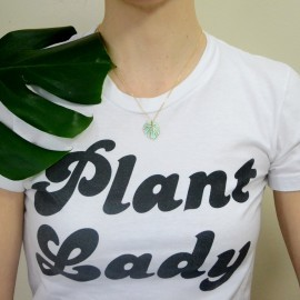 gold monstera necklace on plant lady