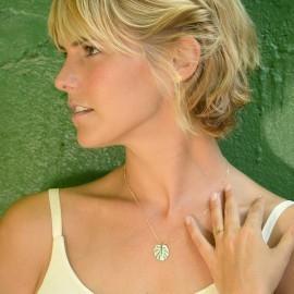 gold monstera necklace mint on model 1