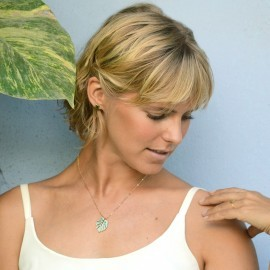 gold monstera necklace mint on model 3
