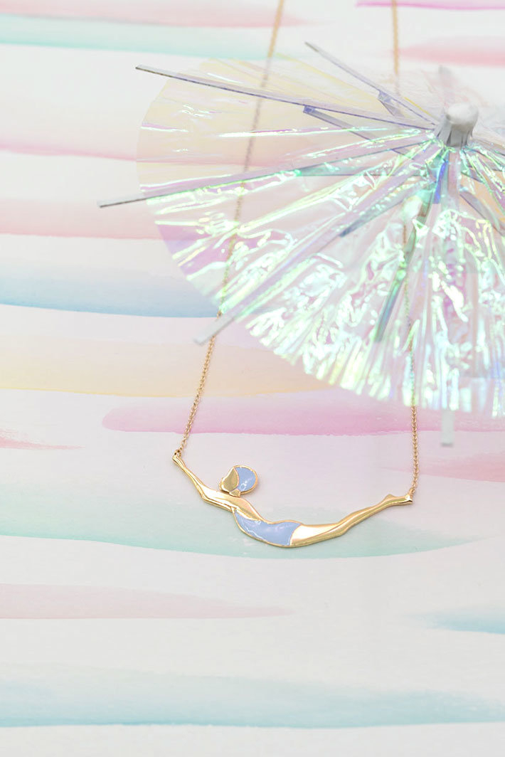 Gold swimmer necklace with enamel