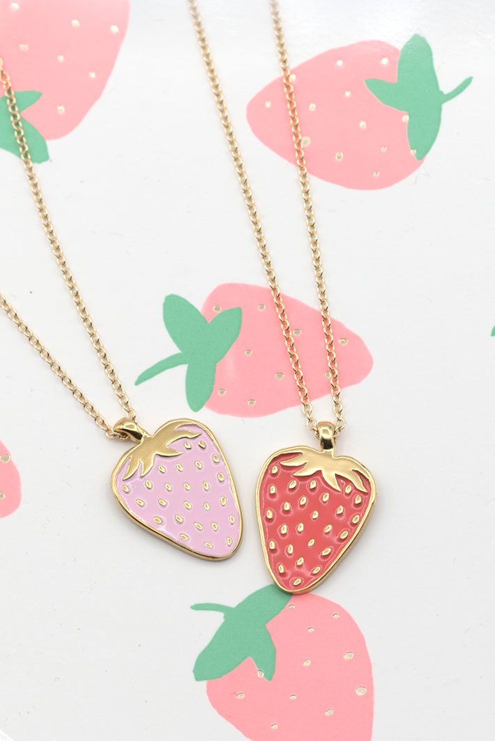 two gold strawberry necklaces