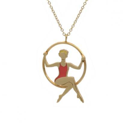 blond hoop aerialist necklace with coral leotard gold